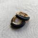 argollas doradas de clip con negro