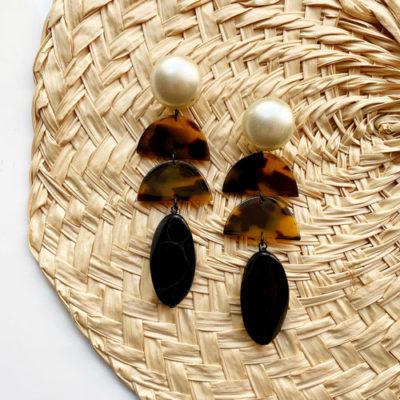 aros perla y negro de resina