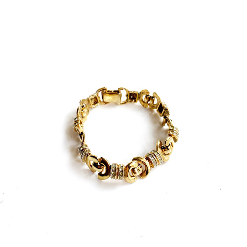 pulsera de metal dorada finitia