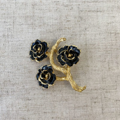 broches flores negras