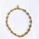 collar corto dorado con cristales