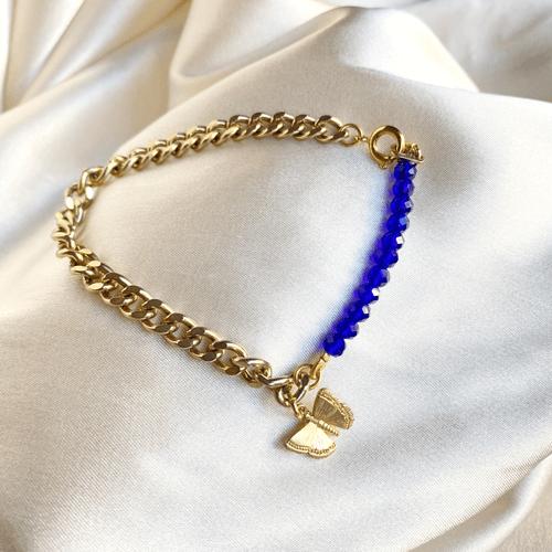 pulsera dorada con azul