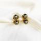 aros de perlas verde y dorado