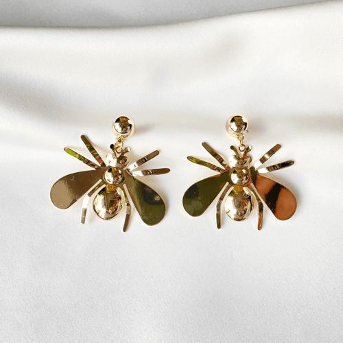 aros dorados de abejas